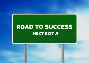 bigstock-Road-To-Success-Highway-Sign-21411533